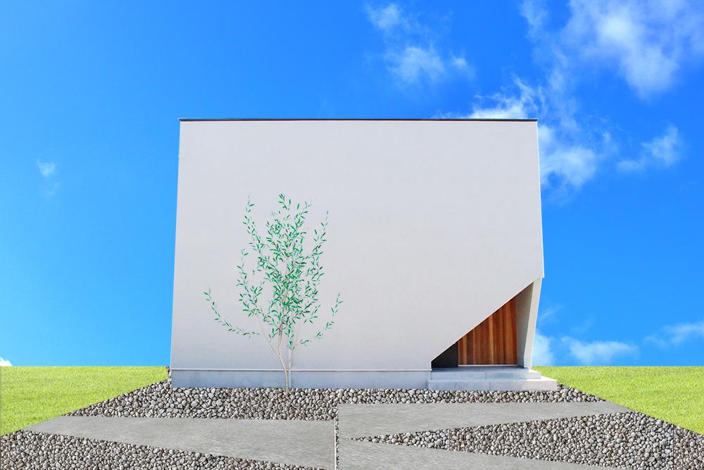 白い外壁が印象的な箱型の家